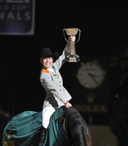 Meredith Michaels-Beerbaum with World Cup Trophy riding stand-in horse